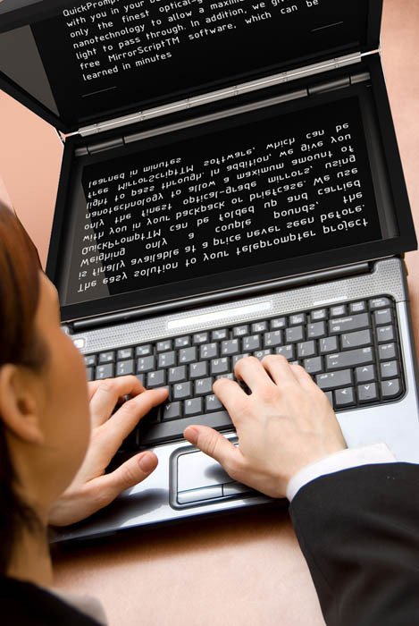 Woman At The Office Working On Her Laptop